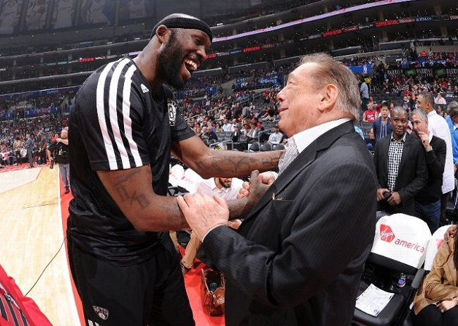 Clippers owner Donald Sterling (r) with former Clipper and current Kings PF Reggie Evans.