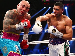 Amir Khan (r) lands a right hand against Luis Collazo.