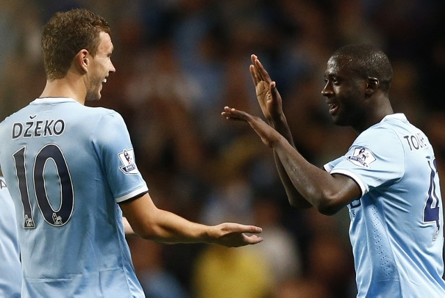 Manchester City's Edin Dzeko (left) and Yaya Toure.