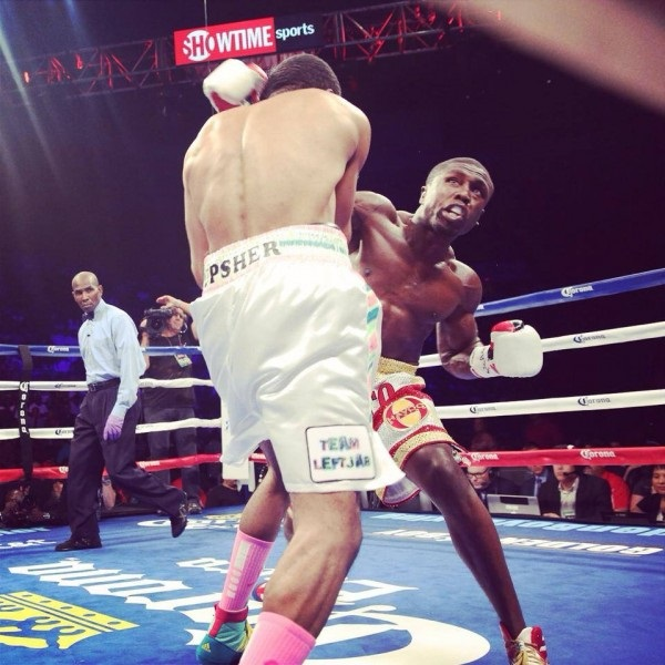 Kamal Hasan referees a welterweight bout between Andre Berto (right) and Steve Upsher.