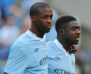 Yaya (left) and Kolo Toure with Manchester City.