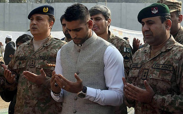 Amir Khan visited Peshawar, Pakistan, school on Dec. 29, 2014.