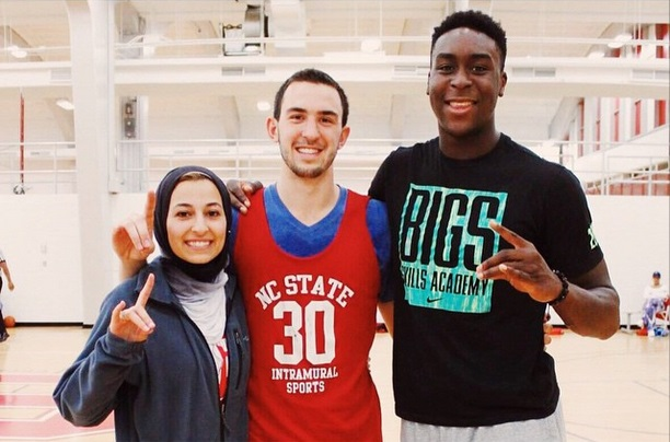 NC State forward Abdul-Malik Abu (right) with Deah Shaddy Barakat and Yusor Mohammad Abu-Salha.