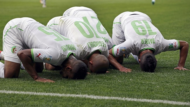 Members of the Algerian national team pray during the 2014 FIFA World Cup.