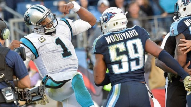 Cam Newton (#1) aggravates the Tennessee Titans.