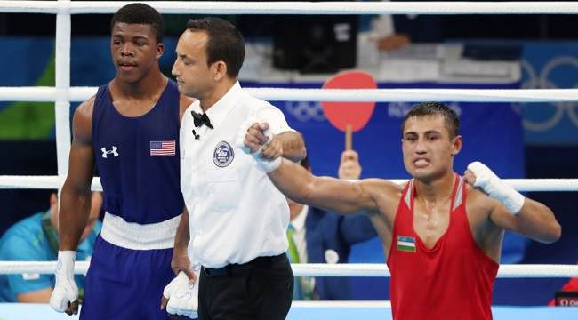 Fazliddin Gaibnazarov of Uzbekistan (right) defeated Gary Russell of the U.S.