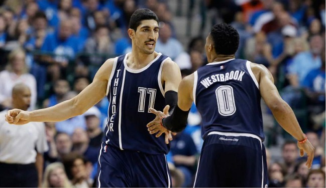 OKC Thunder center Enes Kanter (left) with teammate Russell Westbrook.