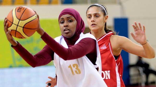 Amel Saleh (No. 13) of the Qatari women's national basketball team.